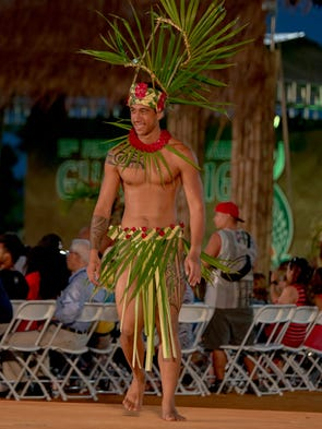 Delegates from Tahiti shows off their traditional wear