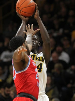 Iowa's Peter Jok shoots a 3-pointer during the Hawkeyes'