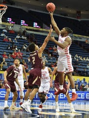 Frank Bartley IV puts up a shot Friday in UL's 80-54 win over Texas State in the quarterfinal round of the Sun Belt Tournament in New Orleans. He finished with 23 points for the Cajuns.