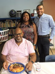 Jimmy Washington, seated, with Crystal and Kenrick