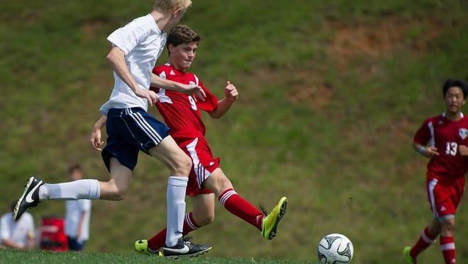 Carolina Day soccer player Tyson Hichman (9).