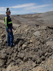 Joshua Kantor, managing supervisor of drilling and blasting looks over the Dixon Pit, Wednesday at the Navajo Mine in Nenahnezad..