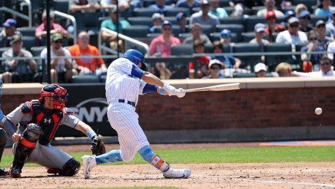 Jun 18, 2017; New York City, NY, USA; New York Mets left fielder Michael Conforto (30) hits an RBI single during the fourth inning against the Washington Nationals at Citi Field. Mandatory Credit: Anthony Gruppuso-USA TODAY Sports