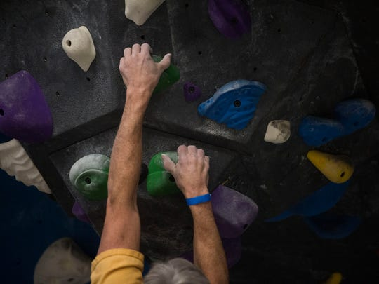 Kelly Brown of Knoxville participates in a bouldering competition Saturday, Feb. 25, 2017, at Onsight Rock Gym in Knoxville.