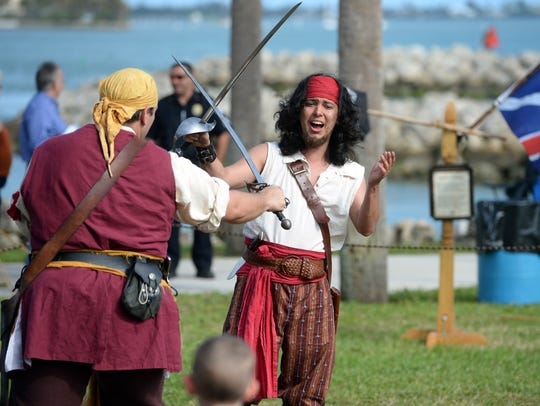 The fourth annual Vero Beach Pirate Festival is this weekend at Riverside Park. In this photo, Diego Bermudez (center), of Gainesville, and Tony Noble (left), of Largo, give a weapons demonstration on Friday, Feb. 2, 2018, at the ninth annual Treasure Coast Pirate Festival at Veterans Memorial Park in Fort Pierce.