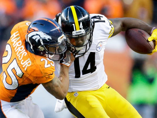 Pittsburgh Steelers wide receiver Sammie Coates, right, is tackled by Denver Broncos cornerback Chris Harris during the second half in an NFL football divisional playoff game, Sunday, Jan. 17, 2016, in Denver. (AP Photo/Joe Mahoney)