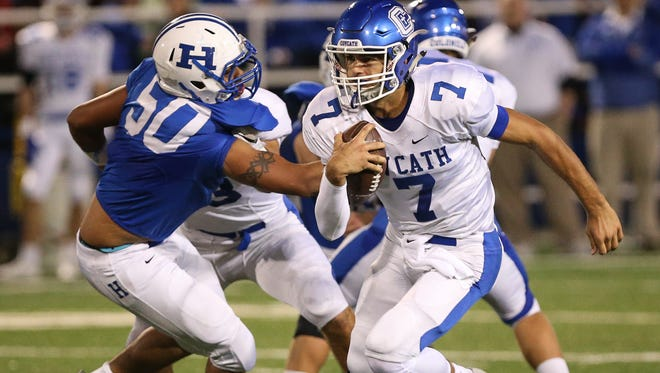 Quarterback AJ Mayer breaks a run up the middle for a long touchdown to put CovCath up 20-0 during their game at Highlands, Friday, October 14, 2016.