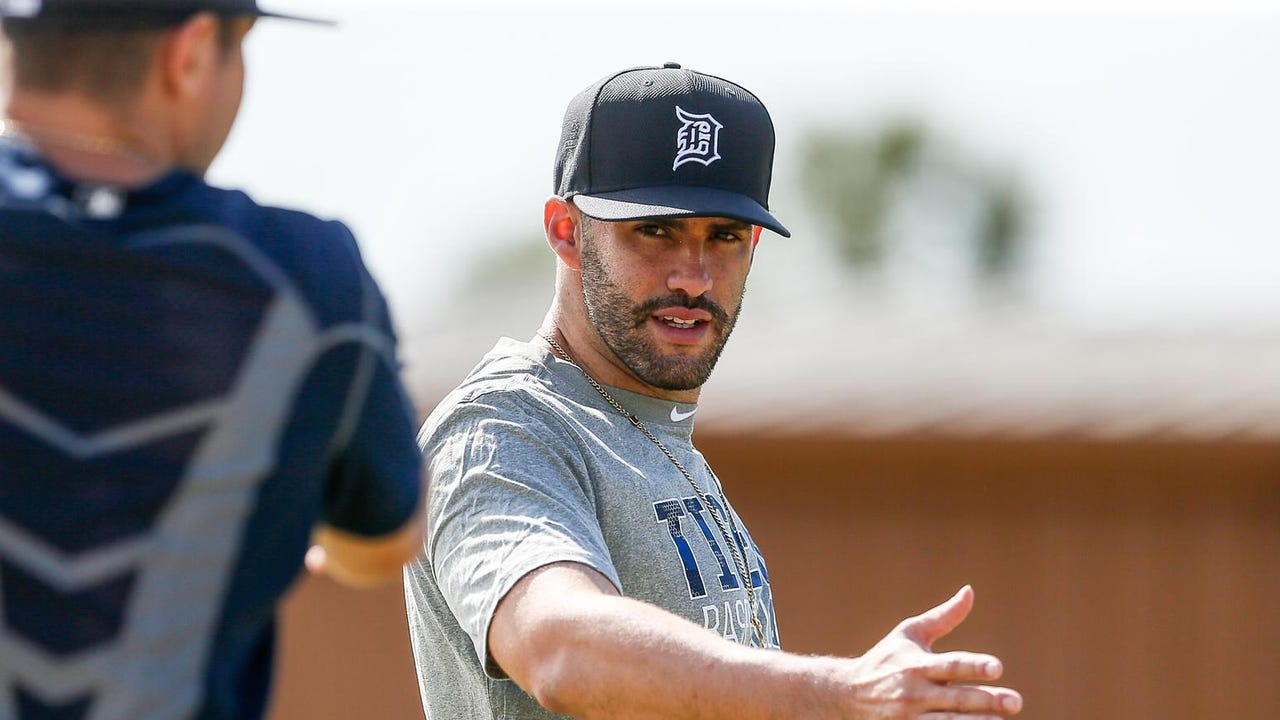 J.D. Martinez takes a few swings in the orange hat
