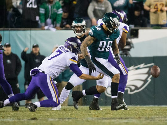 Eagles defensive end Derek Barnett (96) strips the ball away from Vikings quarterback Case Keenum in the NFC Championship game.