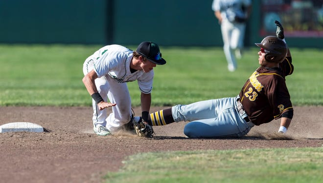 El Diamante's Luke Garispe, left, attempts to apply the tag on Golden West's Wyatt Tilley on Thursday during a West Yosemite League baseball game.