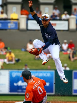 Detroit Tigers shortstop Jose Iglesias (1) jumps to catch a throw over Baltimore Orioles Alex Presley (0) as Presley slides into second base on a steal during the third inning of a spring training baseball game at Publix Field at Joker Marchant Stadium on March 19, 2018; Lakeland, Fla., USA.