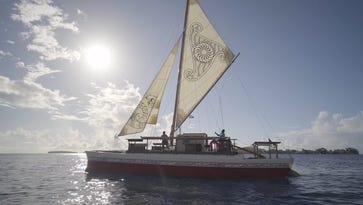 Traditional Polynesian canoe sails to Guam