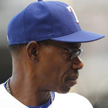 Aug 14, 2014; Arlington, TX, USA; Texas Rangers manager Ron Washington looks on in the third inning against the Tampa Bay Rays at Globe Life Park in Arlington. Mandatory Credit: Matthew Emmons-USA TODAY Sports