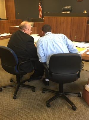 Robert Glene Card Jr., right, confers with his lawyer, John Livesay, on Friday in St. Clair County Circuit Court.