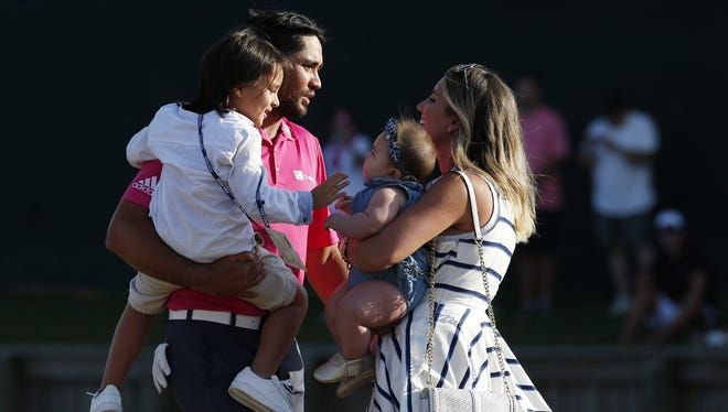 Jason Day celebrates with wife Ellie Day, son Dash Day and daughter Lucy Day after winning the 2016 Players Championship golf tournament at TPC Sawgrass - Stadium Course.