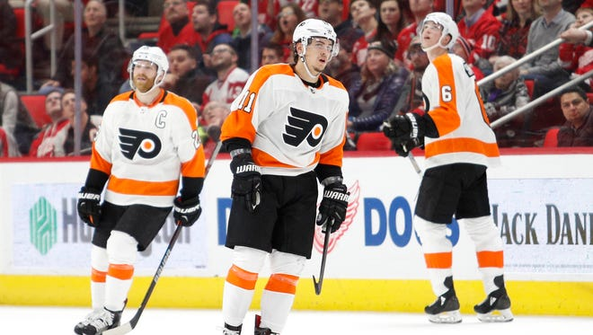 Travis Konecny, center, is part of the Flyers' new nucleus and will someday take the torch from Claude Giroux, left, and the aging core.