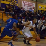 LSUS guard Josh Walker drives to the bucket against Tougaloo's Quintarius Porter on Monday at The Dock.