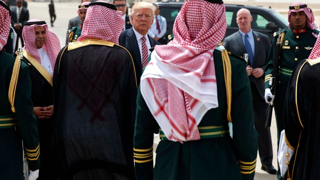 U.S. President Donald Trump boards Air Force One for Israel, the next stop in Trump's international tour, at King Khalid International Airport, Monday, May 22, 2017, in Riyadh.