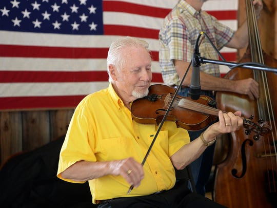 D.J. Spencer plays fiddle with Oliver Rice and the Blue Ridge Mountain Boys bluegrass band during the 58th Hillbilly Day in Mountain Rest on Tuesday.
