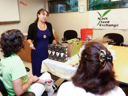 Jennifer Guinta-Hausler, left, co-founder of the Nyack Seed Exchange, gives a lecture at the Nyack Public Library on Saturday, September 23, 2017.