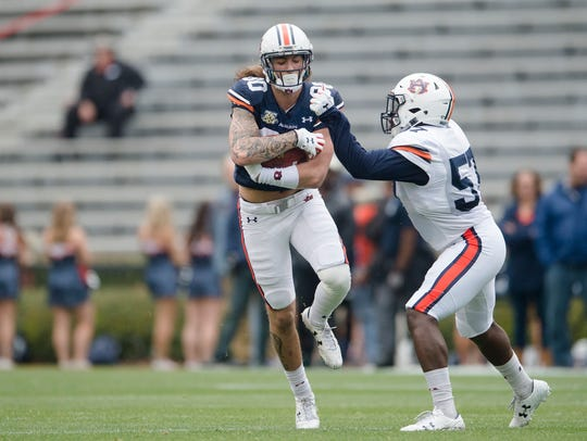 Auburn wide receiver Sal Cannella (80) catches a pass as Auburn linebacker Deshaun Davis (57) defends during A-Day on Saturday, April 7, 2018, in Auburn, Ala