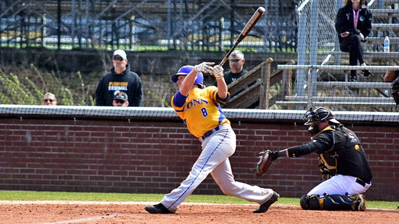 Mountain Heritage graduate Gray McCurry (8) is a sophomore for the Mars Hill baseball team.