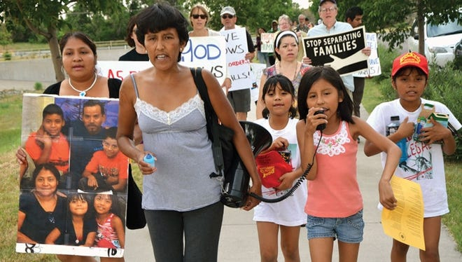 Jeanette-Vizguerra and her daughter lead chants at an immigration rally.