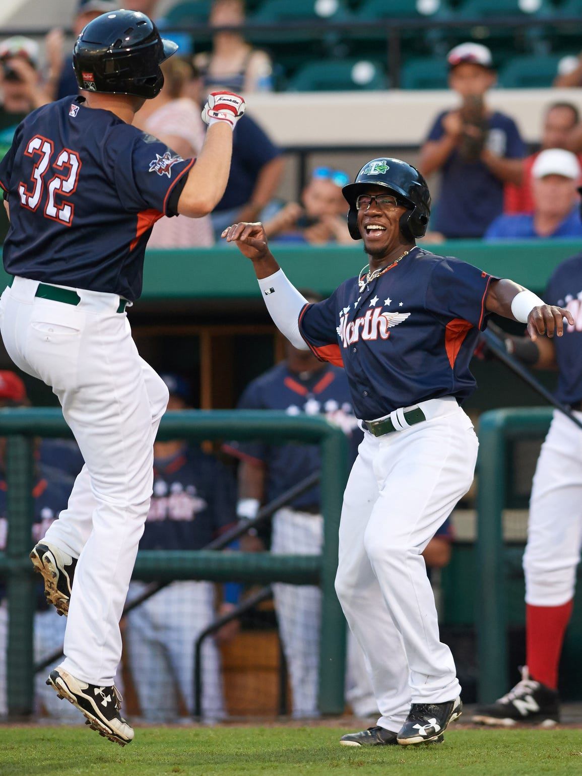 Long celebrates with teammate Gavin LaValley during the Florida State League All-Star Game on June 17.