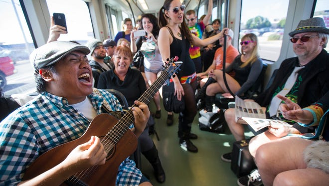 Archie Carry On (that's his name!) sings for other pantless riders on the light rail train Sunday January 11, 2015. The 7th annual No Pants Light Rail Ride, hosted by Improv AZ, invites participants to go pantsless on the Light Rail in the middle of winter. This is part of The No Pants Subway Ride, which is a global event started by Improv Everywhere in New York in 2002. Forty-seven cities around the world were participating this year according to the Improv AZ website.