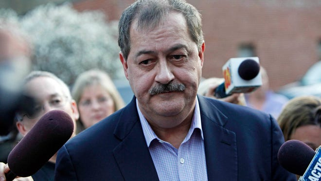 Don Blankenship, former CEO of Massey Energy, speaks with reporters April 6, 2010, after an underground explosion killed 29 people at the Upper Big Branch mine in West Virginia.