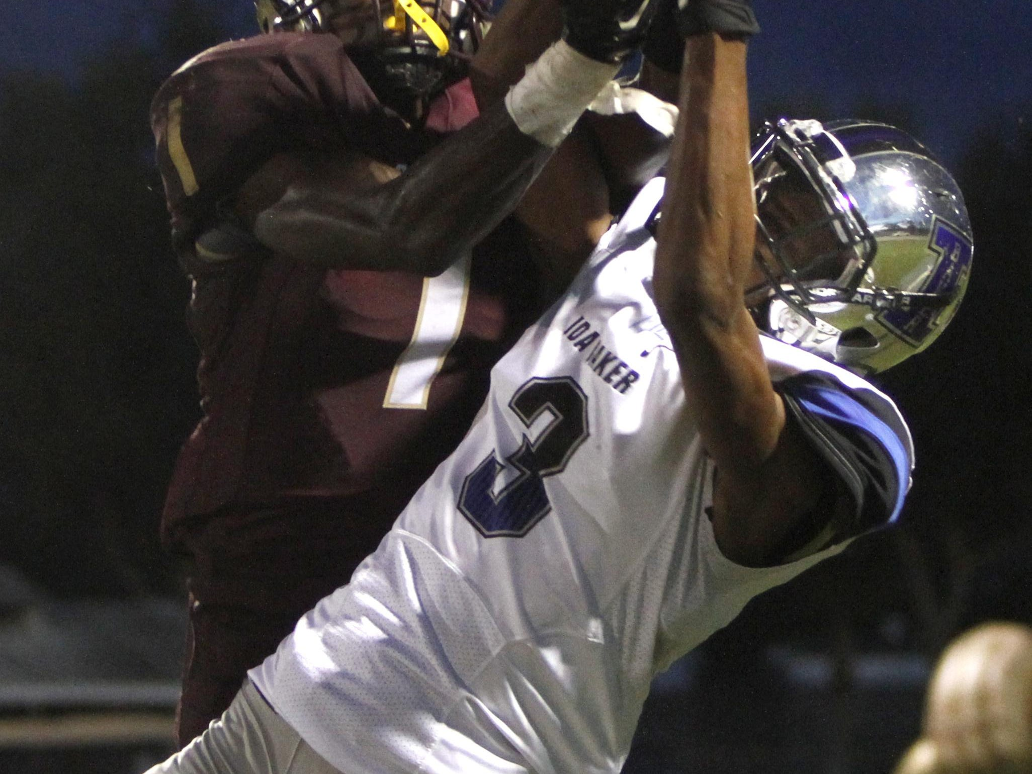 Riverdale's Daniel Malivert and Ida Baker's Rasheed Golden fight for possession of the football as Ida Baker visits Riverdale Friday, September 25. The pass to Golden was incomplete.