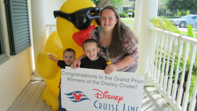 Pamela Kelly, an employee at Red Lobster on Merritt Island, was one of thousands to take their chances with a quacker or two April 13 at the 16th Annual Great Brevard Duck Race during the Indian River Festival at Sand Point Park in Titusville.