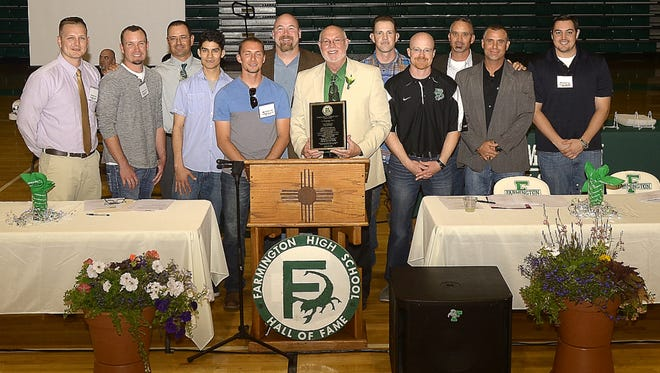 Former Farmington High baseball coach Don Lorett, center, stands for a photo with coaches and players from the 2006 baseball team, which won the 4A state championship. Lorett and the team were inducted into the school's Hall of Fame during a ceremony May 23.