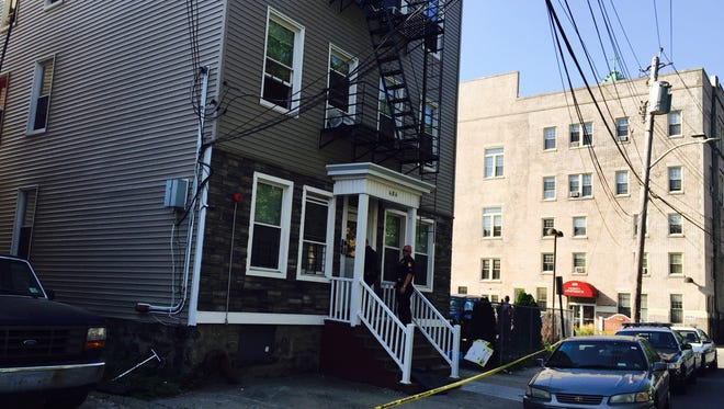 Two Yonkers police officers enter the apartment building at 484 Walnut St. in Yonkers on Tuesday, May 26, 2015, where a girl, 4, was shot in the face late Monday night.
