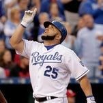 Kansas City Royals designated hitter Kendrys Morales celebrates as he crosses the plate after hitting a two-run home run during the third inning against the St. Louis Cardinals on Friday.