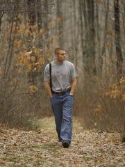 Joel Stephens walks near his home in Tioga, Pennsylvania, in 1998 as he battled colon cancer.