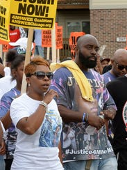 Parents of Michael Brown, Lesley McSpadden, left, and