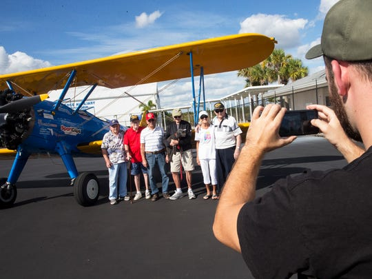 WWII Veterans Jerry Enders, 88, from left, Jack Babb, 91, Bill Kruschel, 91, Bill MacClarence, 93, and Jack Bills, 91,  pose for a photo together in front of a Boeing Stearman before their flight sessions with the Ageless Aviation Dreams Foundation at the Marco Island Executive Airport on Wednesday, Nov. 9, 2016. The Ageless Aviation Dreams Foundation is a non-profit organization established and dedicated to honoring seniors and United States military veterans.