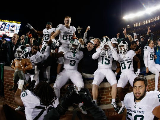 Michigan State's football team, including running back