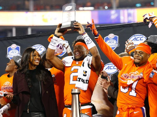 Dec 2, 2017; Charlotte, NC, USA; Clemson Tigers quarterback Kelly Bryant (2) holds up the ACC Championship MVP trophy after defeating the Miami Hurricanes in the ACC championship game at Bank of America Stadium. Mandatory Credit: Jeremy Brevard-USA TODAY Sports