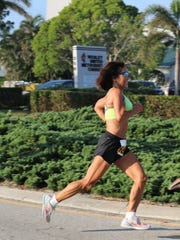 Jeannie Rice, 71, who will run in the Cape Canaveral Air Force Station Lighthouse Foundation Half Marathon, recently broke her own world record for the fastest marathon by a woman age 70 or older. Here she is shown running on Marco Island two years ago.
