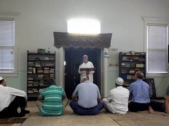 Adel Nefzi, associate imam at Islamic Center of Fort Pierce, addresses worshippers on Friday, Sept. 16, 2016, during congregational prayers.