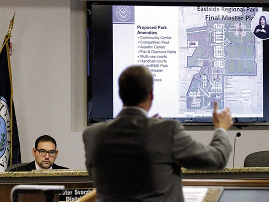 Wayne Cooper, a consultant on the Eastside Regional Park plan, goes over the proposal with members of the City Council during its regular meeting Tuesday morning.