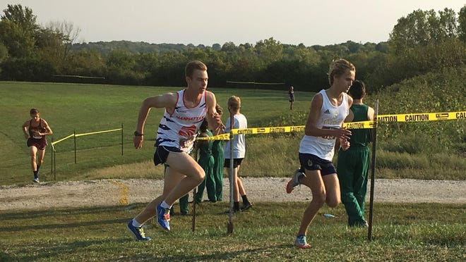 Hayden's Tanner Newkirk, right, and Manhattan's Daniel Harkin duel at the end of Saturday's Sunflower Showdown at T-Town at Washburn Rural. Newkirk won in a time of 15:40.7 while Harkin was second in 15:41.9.