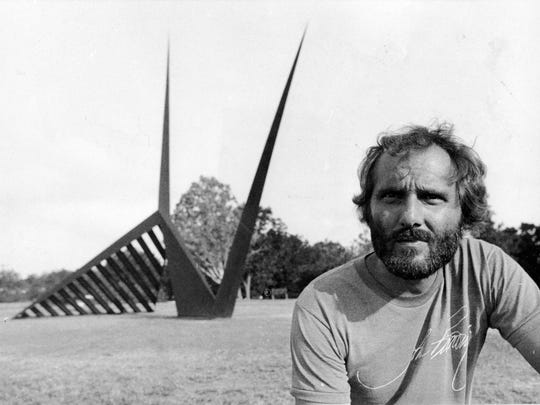 "Sculptor John Raimondi in front of his sculpture ""Ran"""