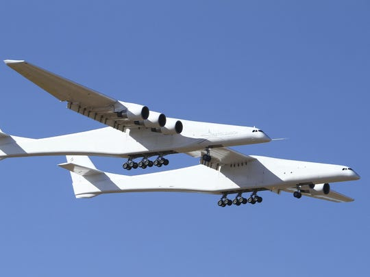 The  twin-fuselage Stratolaunch is designed to carry up to three satellite-laden rockets at a time under its 385 foot wing.