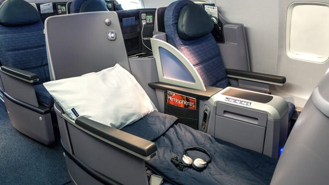 The BusinessFirst cabins on United's transcontinental p.s. routes sport 28 180-degree flat-bed seats.