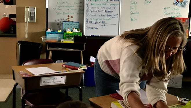 Wendy Read helps students in a combination third- and fourth-grade class at Idyllwild School on Friday, Dec. 8, 2017. Generators helped keep the school open during a power outage.