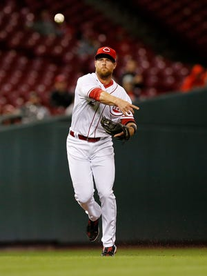 Cincinnati Reds shortstop Zack Cozart (2) fields a ground ball Philadelphia Phillies left fielder Howie Kendrick (47) in the top of the third inning.