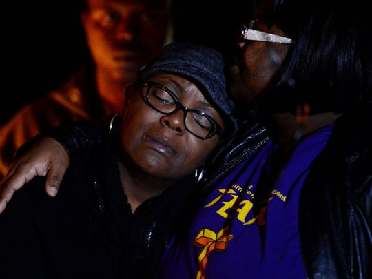 "Deidra Walls, left, and Leandrea Ward share a hug during the ""Break the Silence Against Domestic Violence"" candlelight vigil at East Kings Highway Park."
